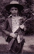 young dale 1950 with bbgun and cowboy hat